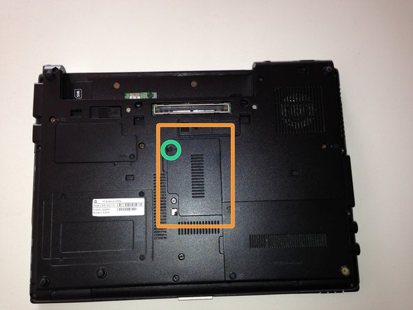 Locate the RAM expansion slot cover on the bottom of the laptop