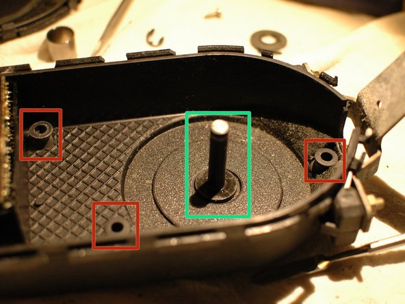 Remove the three rubber buffers.