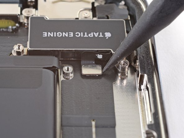 Use the point of a spudger to pry the Taptic Engine cable connector straight up and out of its socket on the logic board.