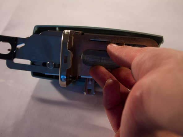 Place the template into The Buttonholer, and then close the retainer plate.