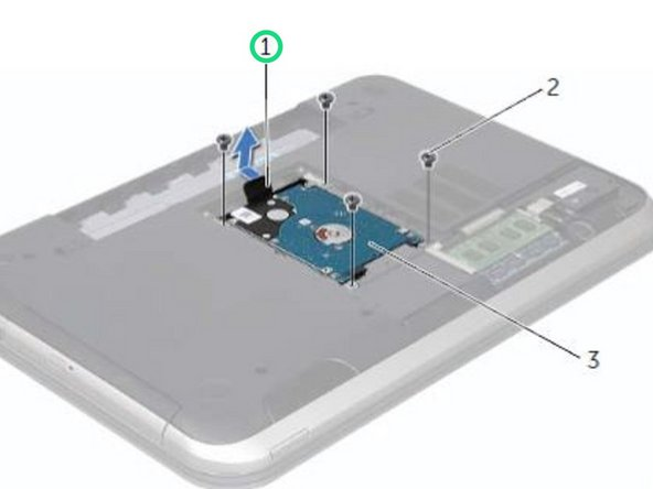 Using the pull-tab, slide the hard-drive assembly toward the back of the computer to disconnect the hard-drive assembly from the connector on the system board.