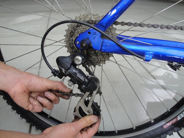 Rout the chain around the front chain rings and rear derailleur.