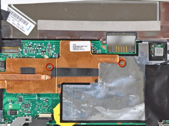 Remove the two 2.5 mm Phillips screws securing the heat sink to the motherboard.