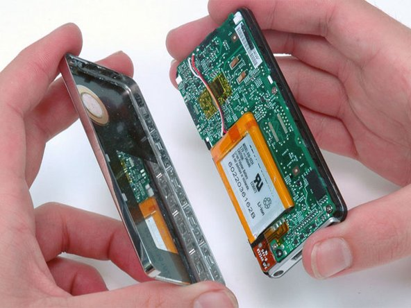 After ensuring all tabs are free, separate the two halves of the iPod.
