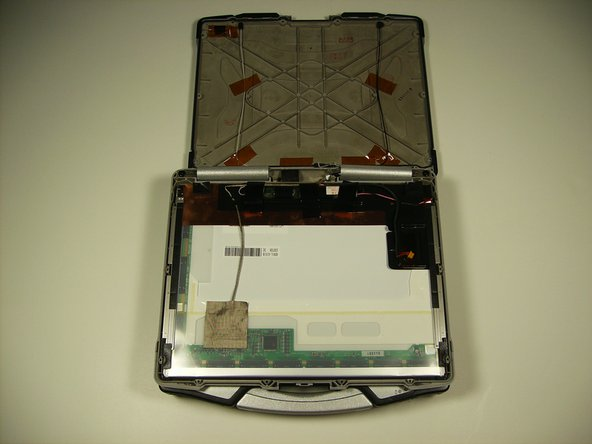 The top half of the case can be removed by sliding the tabs out from under the hinges.