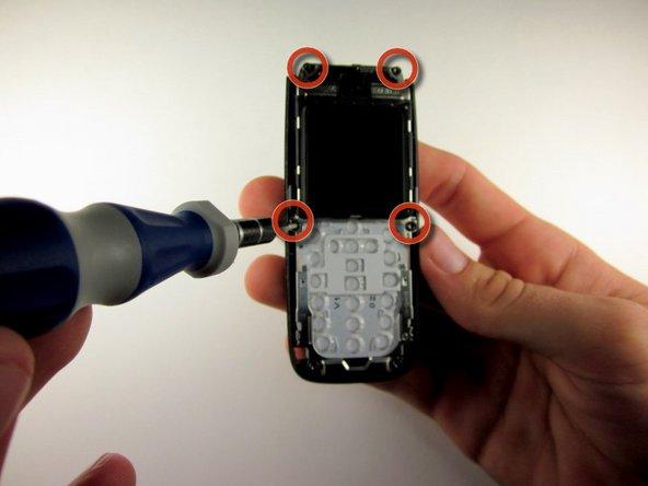 Remove the 4 screws surrounding the screen using the precision T6 screwdriver.
