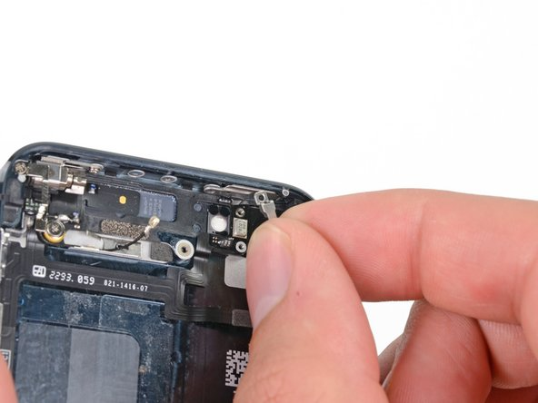 Remove the metal bracket between the rear facing flash and camera windows.