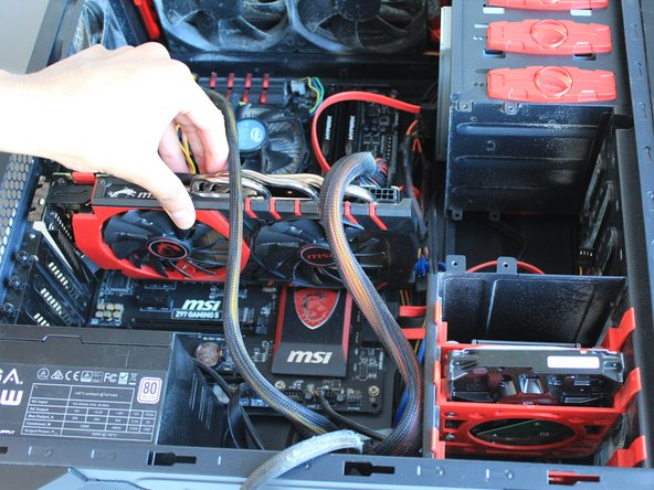 Line up the GPU with the PCI-E Slot.