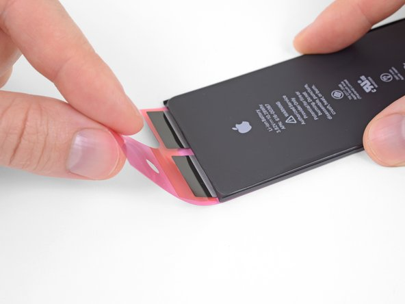Repeat the previous step to adhere the ends of the two remaining strips at the top edge of the battery.