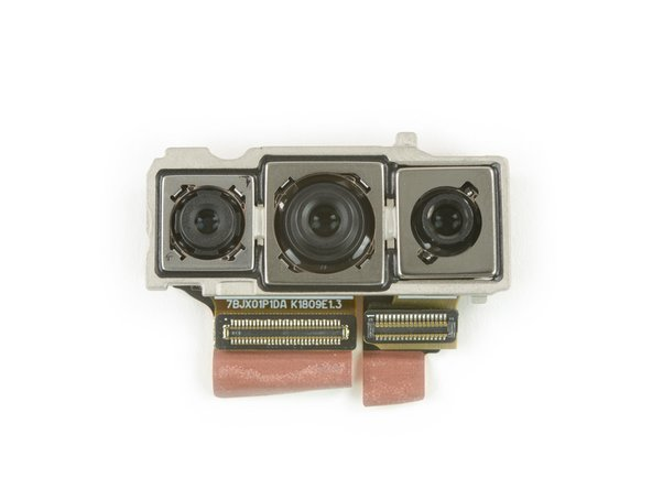 The three rear cameras get by with just two connectors—the main camera and the monochrome camera share one port, while the telephoto camera gets the other all to itself.