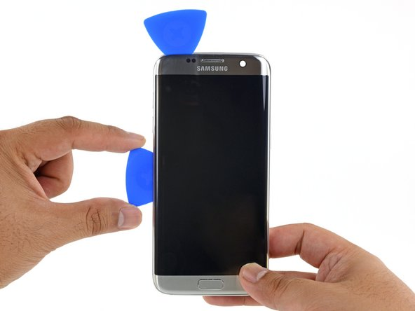 Repeat the previous heating and cutting procedure for the long edges of the phone. Do not cut the bottom edge yet.