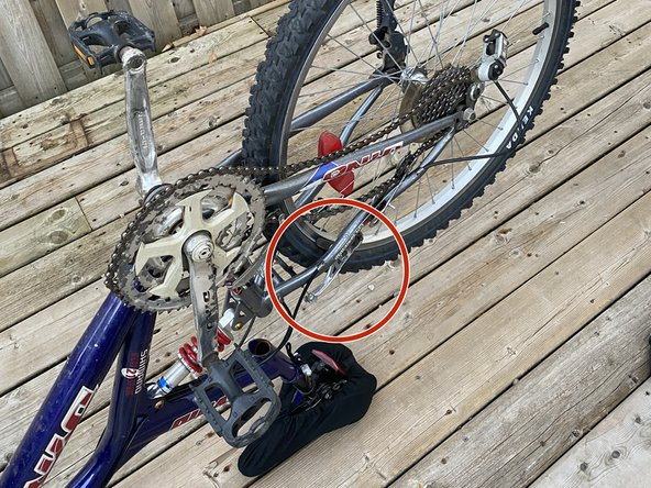 Identify the brake that is rubbing against the bike rim by spinning each wheel while listening for contact.
