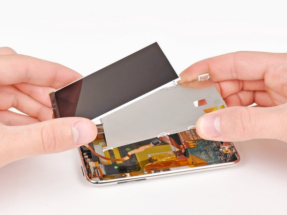 Lift the metal display tray slightly (the battery is attached to its underside) and remove the display from the Touch, minding its delicate cable that may get caught.