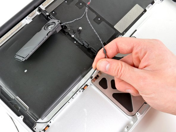 Peel the right speaker cable off the upper case.