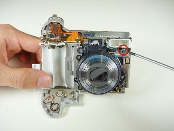Remove the 3 mm screw that holds the flash unit to the camera.