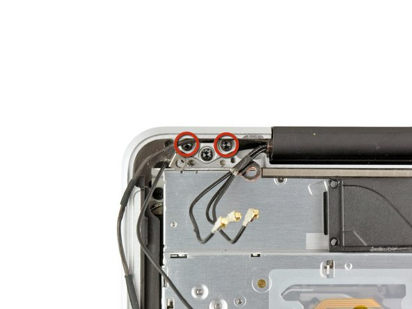 Remove two of the three 6 mm T8 Torx screws securing the right side of the display to the upper case.