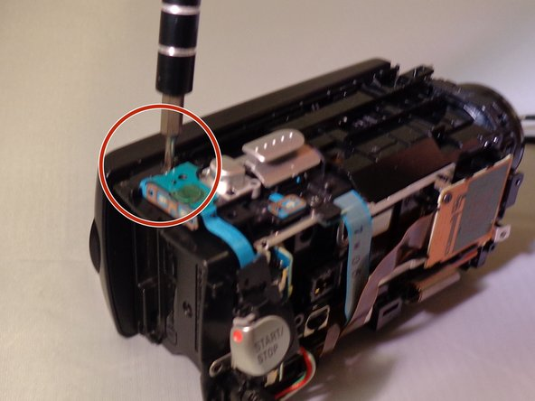Remove one 5 screw near the top, back left section near the zoom and picture control capturing button.