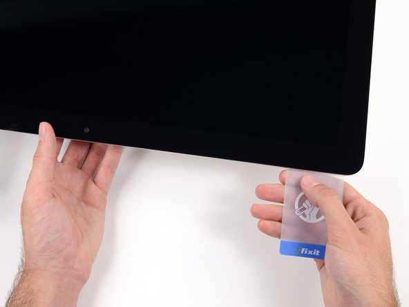 Slide the plastic card toward the center.