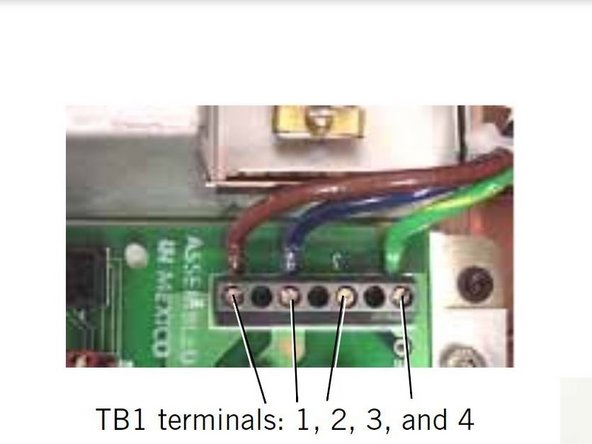 Loosen the screws on power supply connector TB1 (page 10-22 of Service Manual).