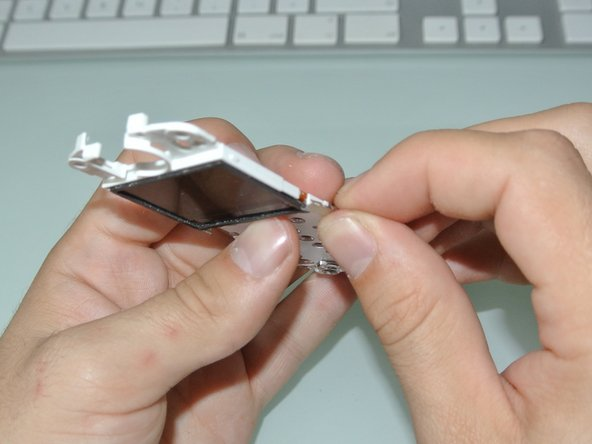Remove the two small metal clips keeping the cables safe.