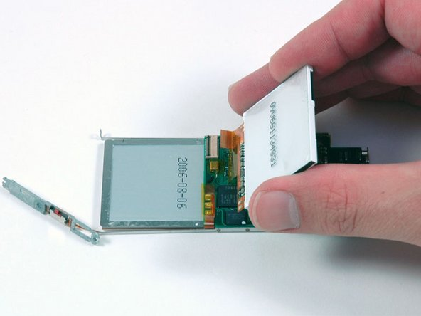 Slide the display ribbon out of its connector and lift the display off of the logic board.
