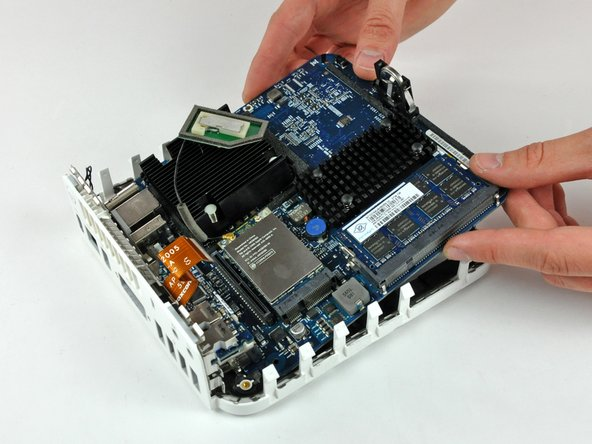 Gently lift the free end of the logic board and wiggle the board as you pull it away from the I/O ports.