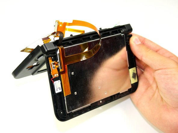 Open the hinge and carefully pop off the Upper LCD using your fingers.