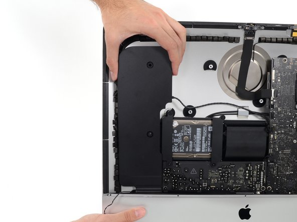 Lift the left speaker straight up and remove it from the iMac.