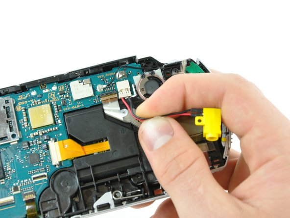 Disconnect the power jack from its connector on the motherboard by pulling it straight out of its socket.