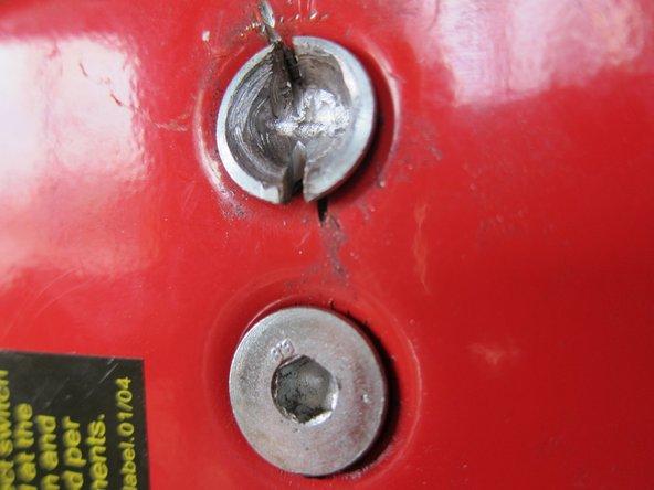 Cut a slot into the screw head.