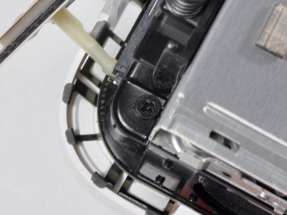 Remove the black Phillips screw located on the upper right corner.