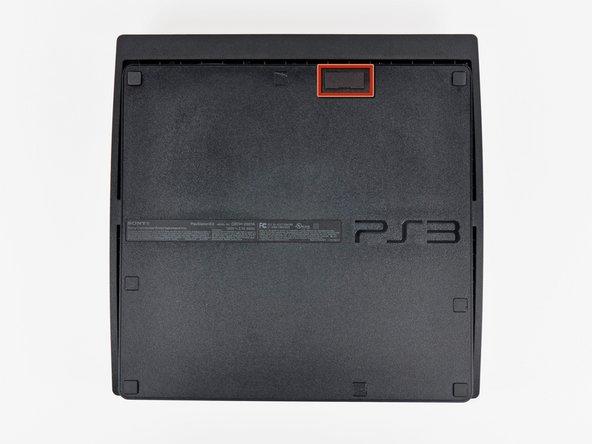 Retournez la PS3 et posez-la à l'envers.