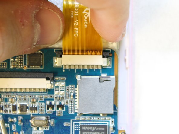 Gently pull on the ribbon cable, separating it from the socket.
