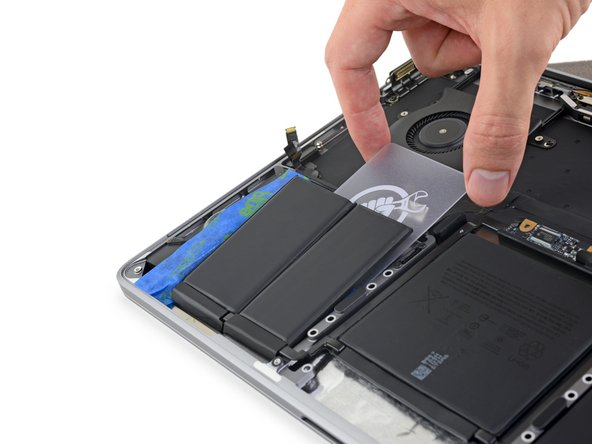 Use your plastic card to fully separate the remaining battery cell on the left side.