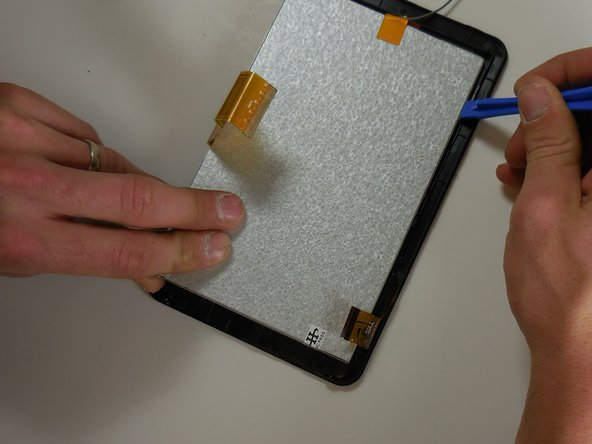 Use plastic opening tools to remove screen from front cover.