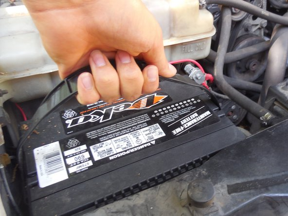 Now lift out the battery using the handle shown.