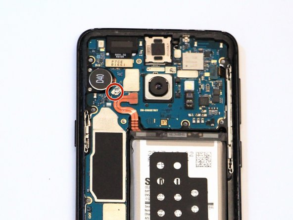 Remove one 3mm screw with a #000 Phillips screwdriver.