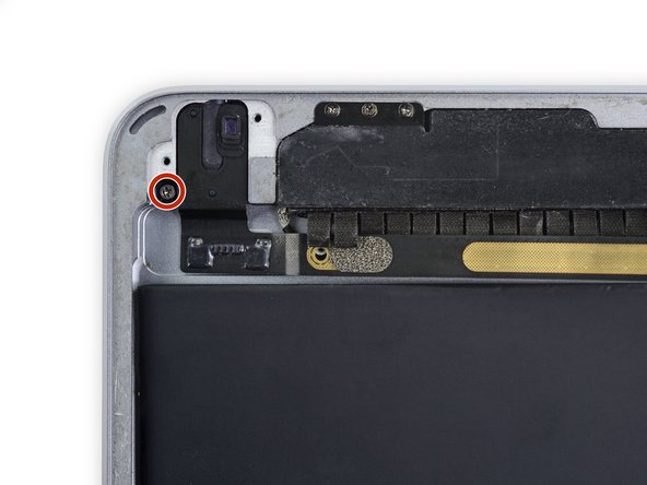 Remove the single 2.8 mm Phillips screw securing the headphone jack to the rear case.