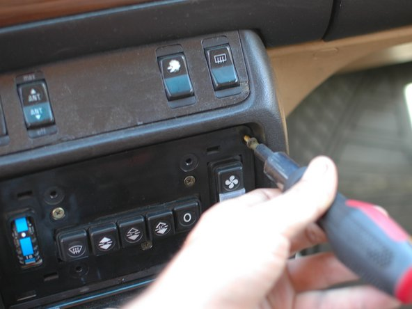While we have the climate control wood trim off, however, let's proceed to replace the trim around the center stack switches as well.