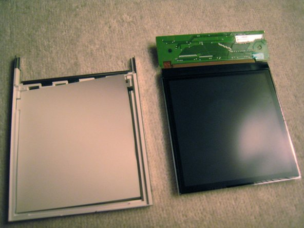 The screen is sandwiched in a metal case.  It didn't seem clipped together but it was a snug fit. I pushed on the circuit board through the cutouts in the metal to pry the pieces apart.