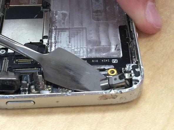 Unscrew the screw holding onto the vibrator.