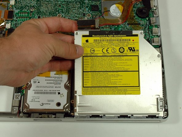 Lift the optical drive out of the computer from the side with the connector on it.