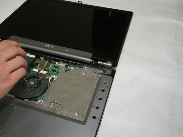 Use a spudger to detach and remove cables from the motherboard.