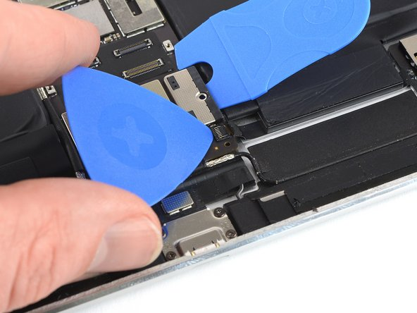 Use an opening pick to flip up the locking flap on the ZIF connector.
