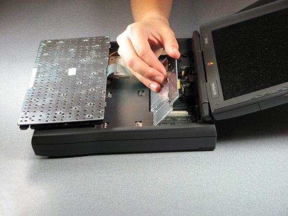 Lift the heatsink from the side closest to the laptop screen.