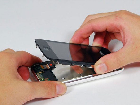 The display assembly is still connected to the iPhone by several cables, so don't try to remove it entirely just yet.