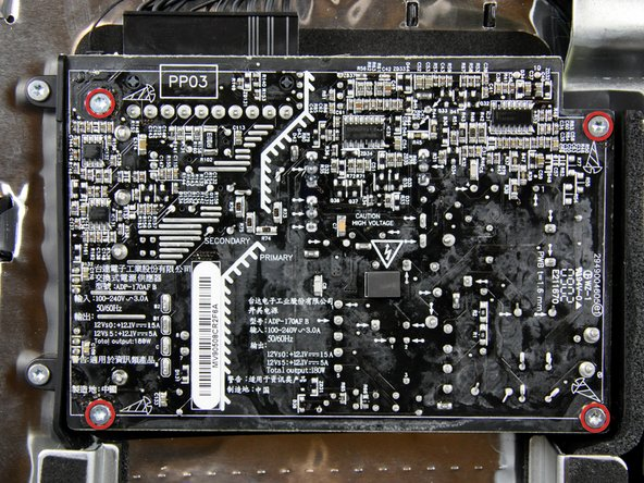 The next few steps bring your hands close to the exposed face of the power supply. Do not touch the face of the power supply to avoid a high voltage shock from the many large capacitors attached to the board.