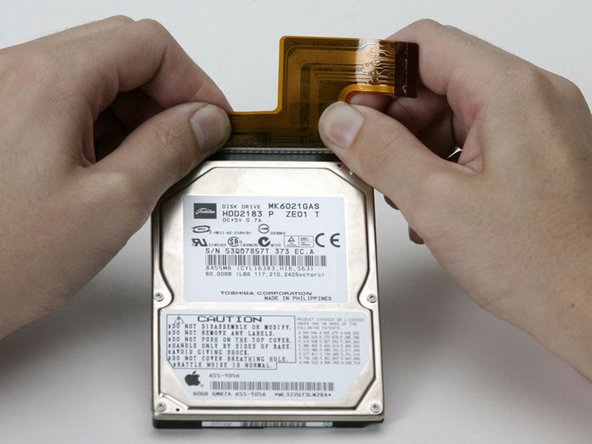 Disconnect the hard drive cable from the hard drive by applying even pressure on both sides while maintaining a firm grip on the drive itself.